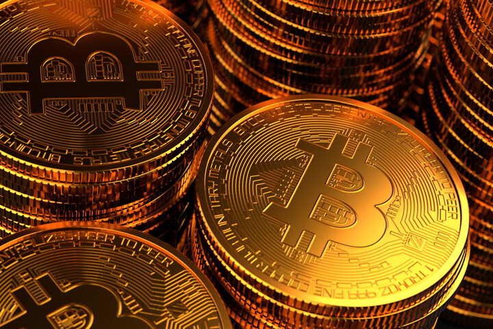 Close-up photo of stacks of Bitcoins with dynamic lighting