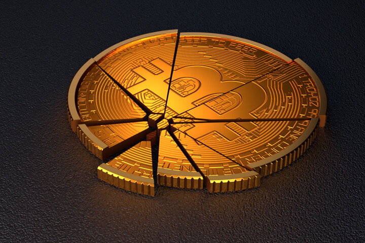 Broken Bitcoin concept for falling prices, cryptocurrency market crash, or price volatility