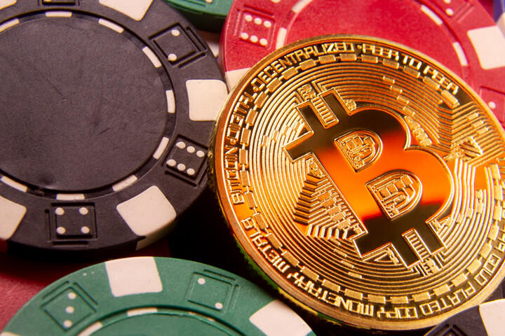 Gold bitcoin on pile of poker chips cryptocurrency risk concept