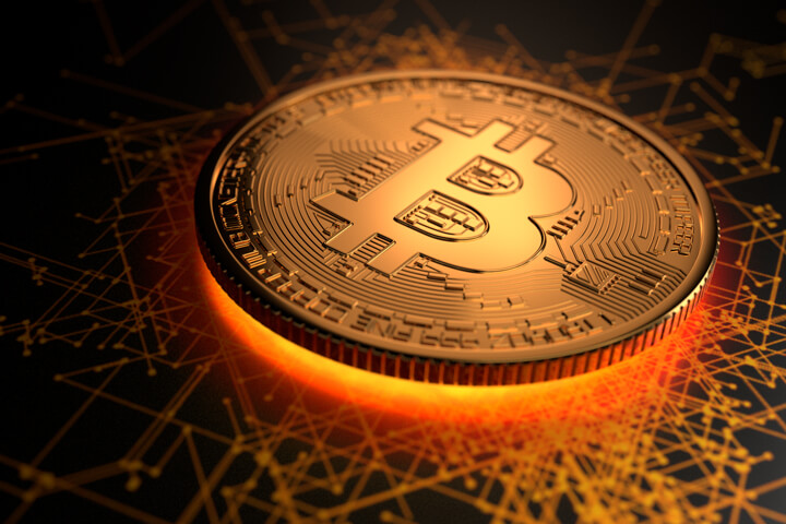 Shiny gold Bitcoin with glowing light emitting from underneath on blockchain background