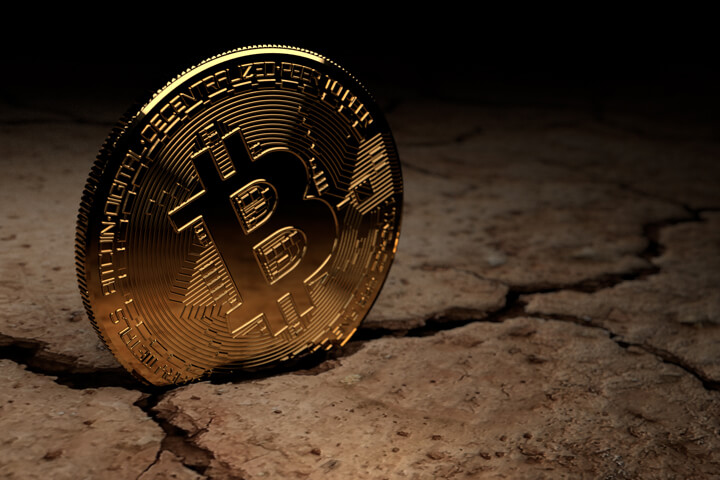 Bitcoin stuck in crack in parched, dry ground
