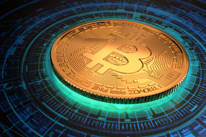 Gold Bitcoin with light emitting from below with circular digital blockchain pattern on background