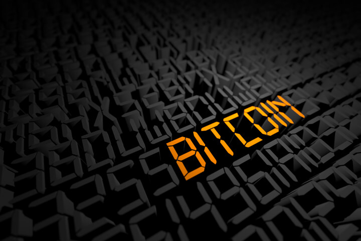 Gold digital Bitcoin text in string of encrypted digital characters
