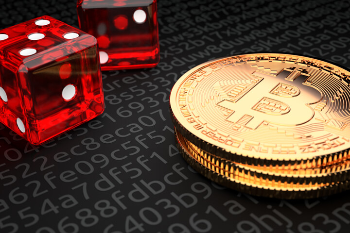 Small stack of Bitcoins with two dice representing Bitcoin investment risk or cryptocurrency risk