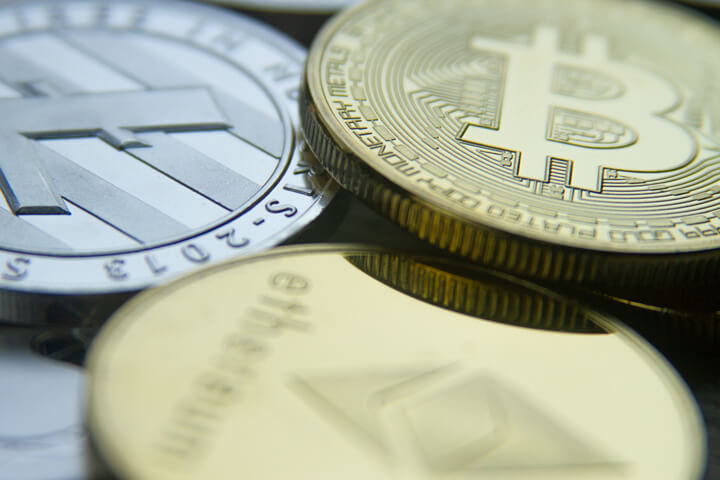 Free photo of a bitcoin, an Ethereum coin, and a Litecoin