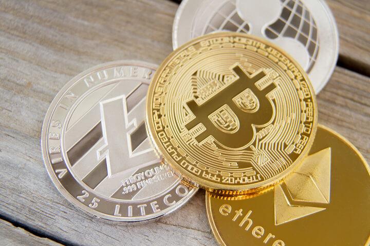 Free photo of a bitcoin, an Ethereum coin, a Litecoin, and a Ripple coin