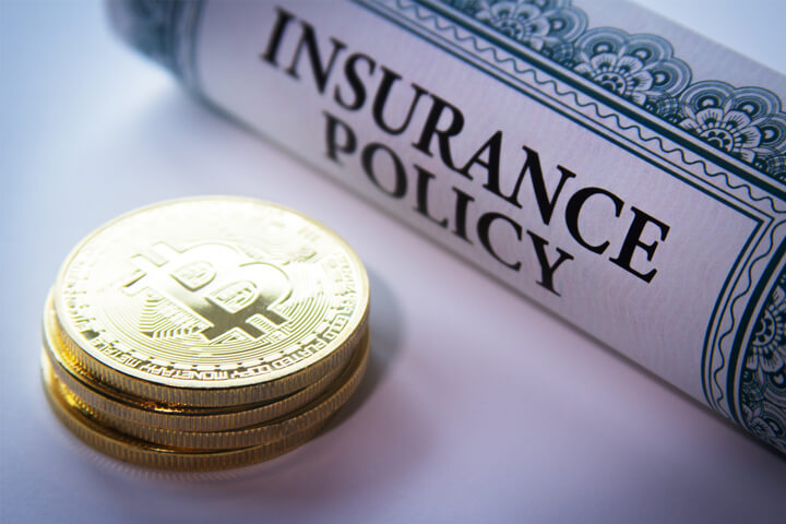 Insurance policy next to stack of Bitcoins concept for Bitcoin insurance