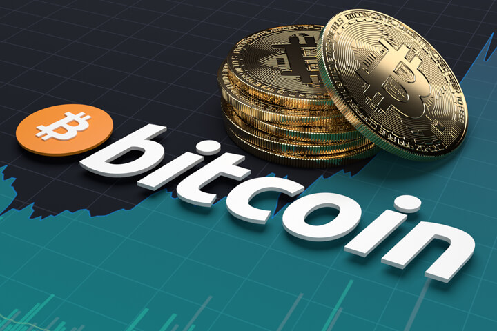 Bitcoin logo on stock price area chart with stack of Bitcoins