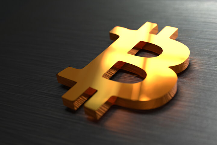 Bitcoin B logo on stainless steel surface with reflection