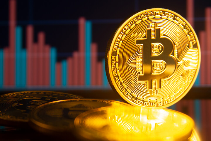 Monitor showing BTC stock trading volume with Bitcoins
