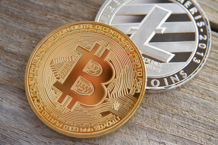 Bitcoin with Litecoin on wood background