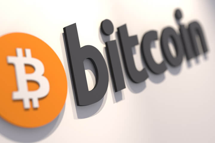 Bitcoin logo on a white painted wall