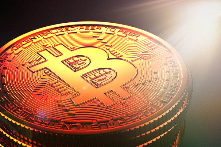 Single stack of Bitcoins with hard corner lighting and lens flare effect