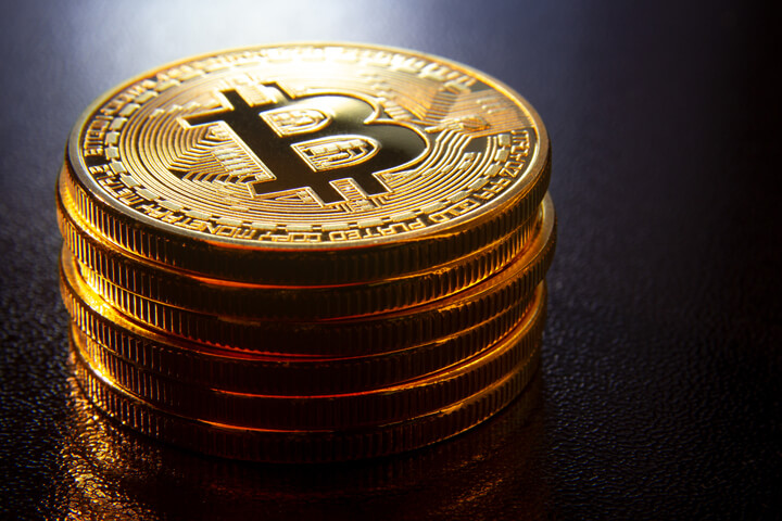 Stack of Bitcoins on reflective textured surface