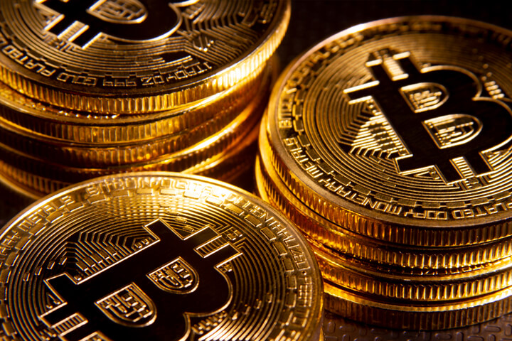 Free photo of three stacks of shiny Bitcoins