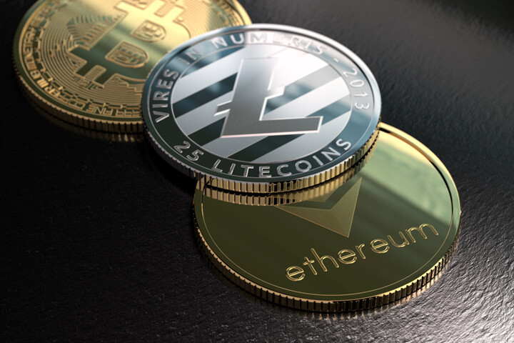Ethereum, Litecoin, and Bitcoin on rough surface with window light