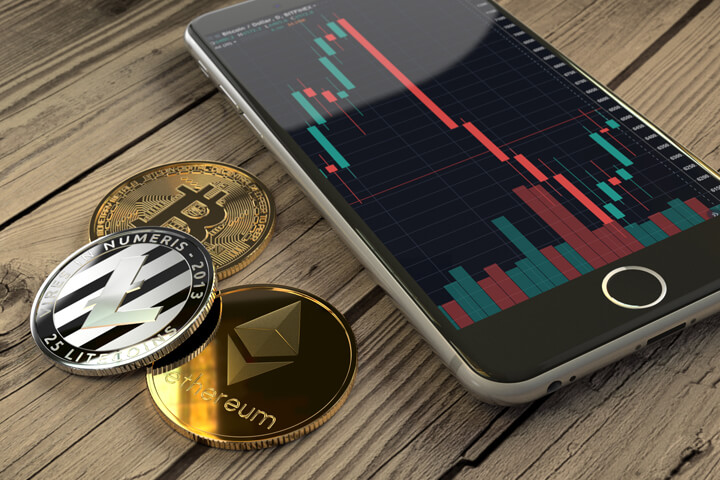 Bitcoin, Ethereum, and Litecoin coins next to iPhone showing candlestick stock chart