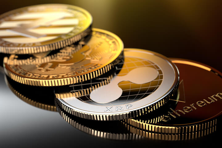 Curved row of crypto coins with gold reflection from window light