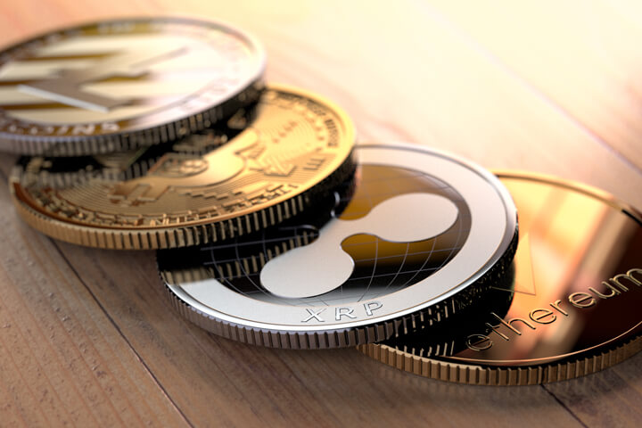 Curved row of cryptocurrency coins on wood floor