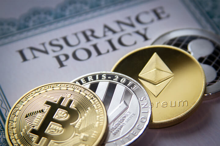 Photo of insurance policy with Bitcoin, Litecoin, Ethereum, and Ripple cryptocurrency coins