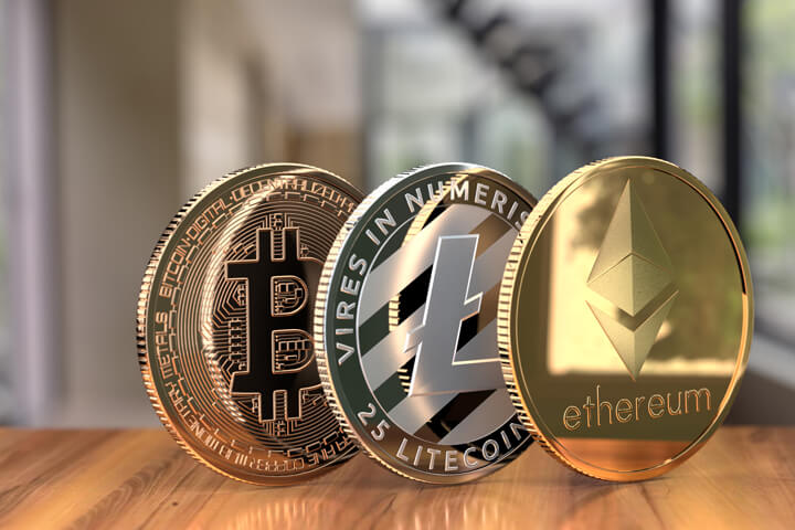 Ethereum, Litecoin, and Bitcoin on edge with luxury home decor in background