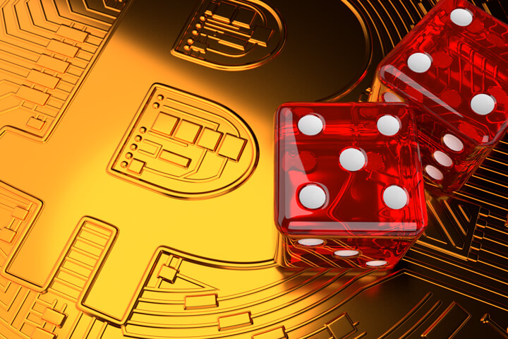 Large shiny Bitcoin with two dice on face representing investment risk in Bitcoin and cryptocurrencies