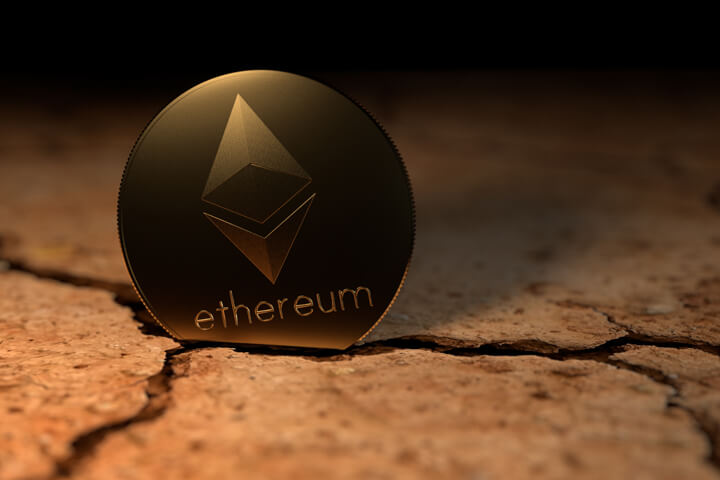 Ethereum crypto coin stuck in cracked earth in desert
