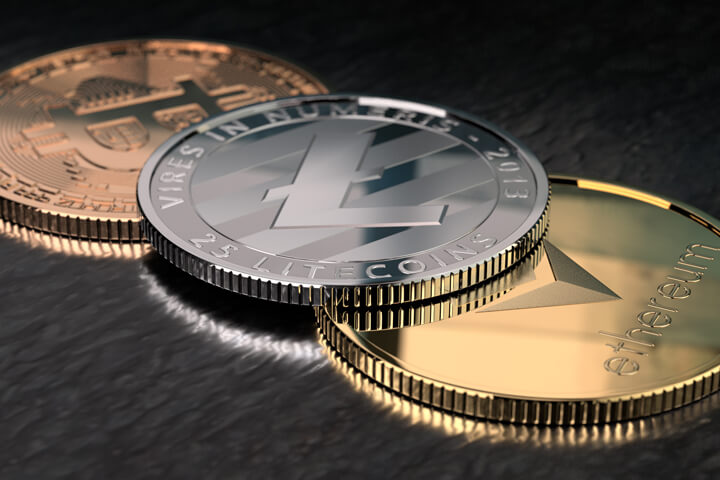 Ethereum, Litecoin, and Bitcoin on textured black surface