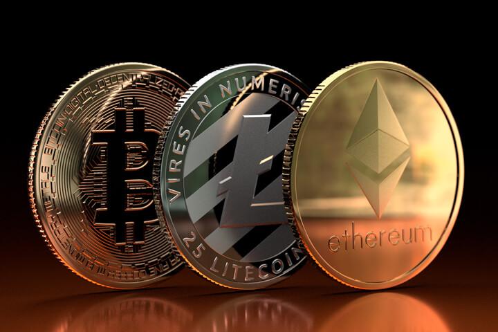 Ethereum, Litecoin, and Bitcoin on edge on reflective orange metallic surface