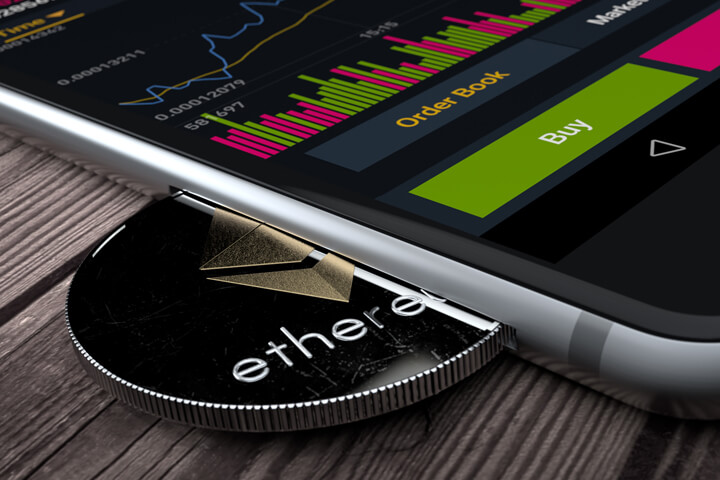 iPhone with Ethereum coin inserted into slot concept for mobile Ether apps, profits, or trades
