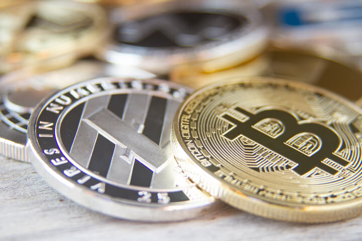 Scattered cryptocurrency coins with focus on Bitcoin and Litecoin