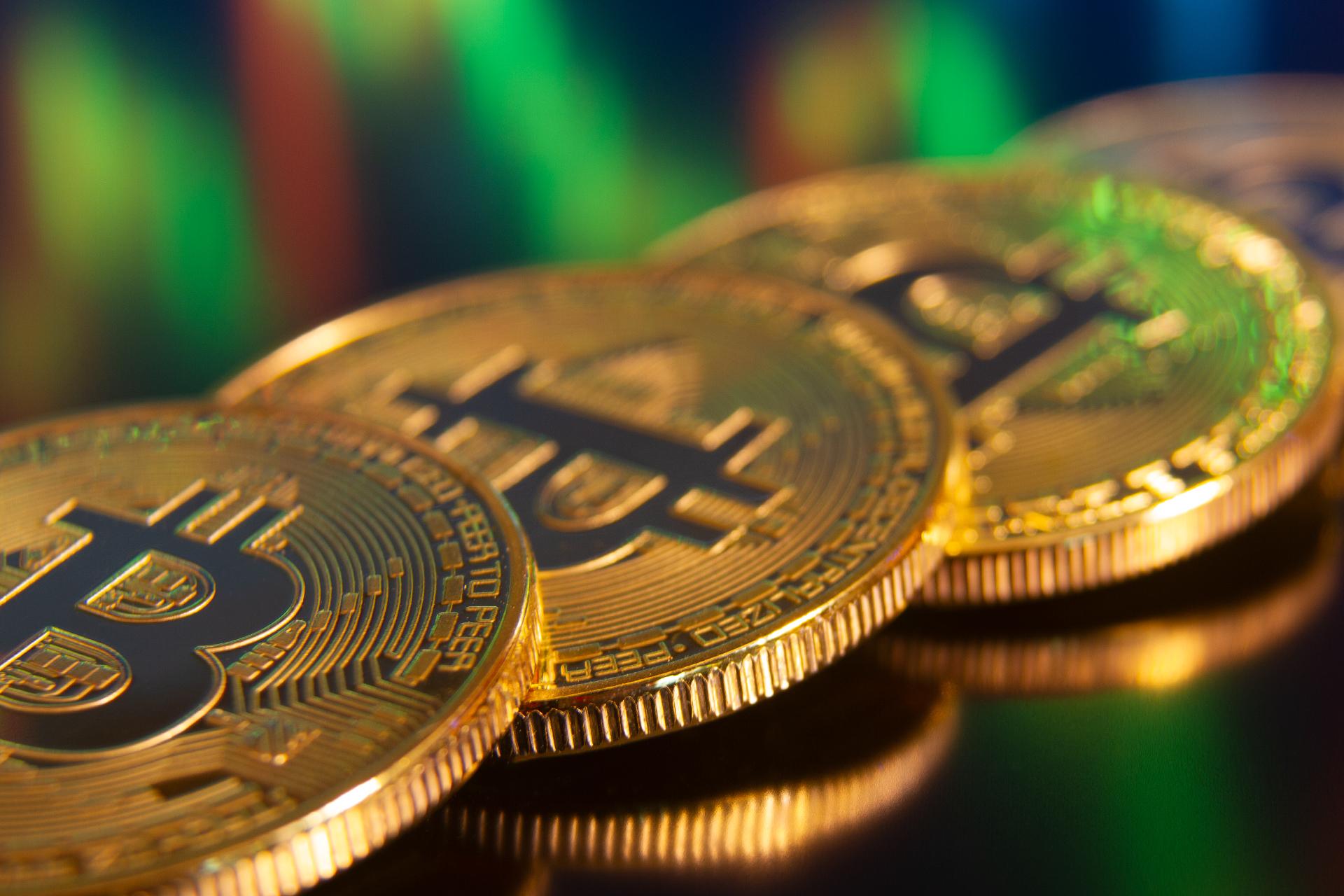 Row of Bitcoins reflecting stock charts free image download