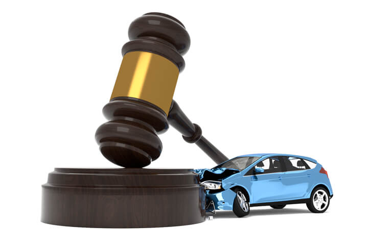 Car crashed into gavel liability insurance concept image