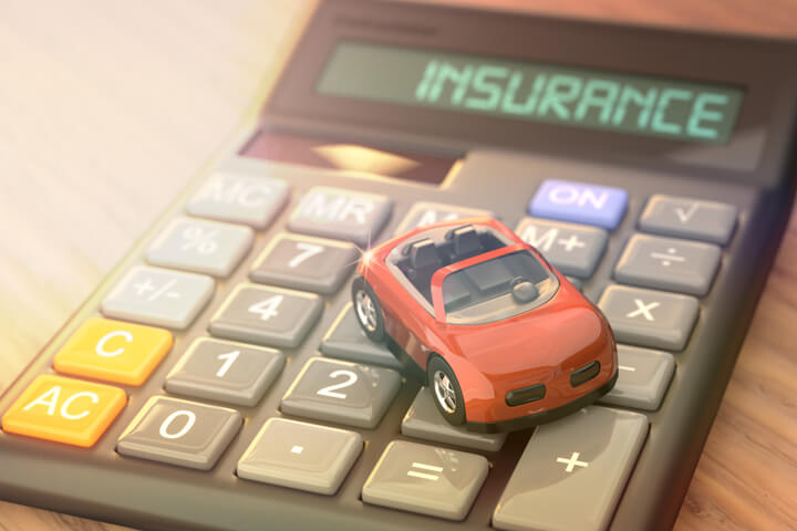 Insurance calculator with small red toy car and light flare effect