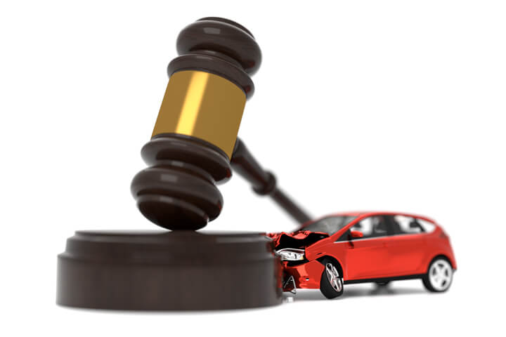 Car crashed into judge gavel concept photo for auto insurance liability