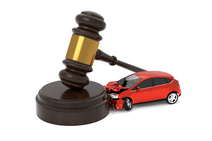 Car crashed into judge gavel concept for car insurance liability isolated on white background