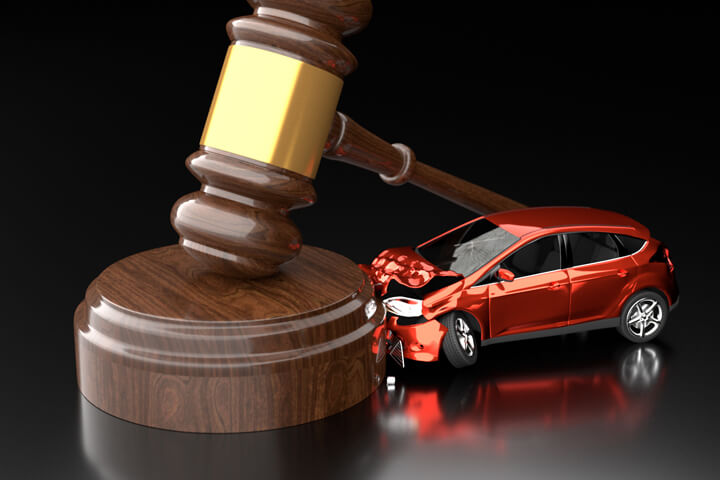 Small car crashed into gavel with dark reflective background