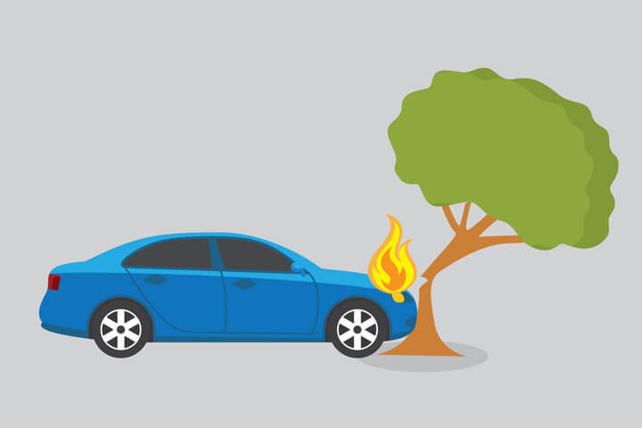 Blue sedan on fire crashed into cracked tree
