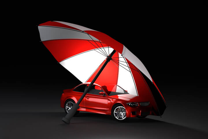 Insurance protection concept of red car under red and white umbrella with dark background
