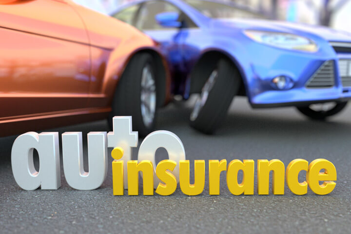 Two car accident blurred in background with words auto insurance in focus