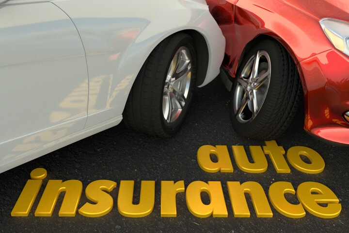 Two car collision showing damage and auto insurance words in foreground