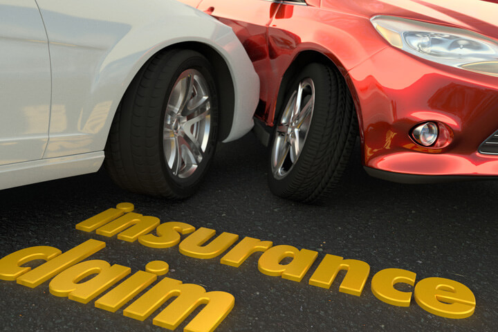 Two car accident close up with insurance claim text on road in foreground
