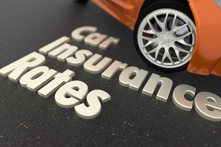 White text car insurance rates on ground in front of orange sports car