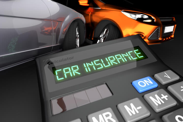 Two car accident in background with calculator LCD showing Car Insurance in foreground