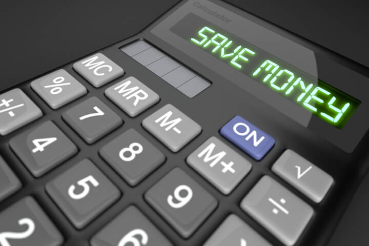 Calculator on dark background with LCD text reading Save Money