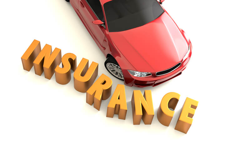Overhead image of car crashing into insurance letters concept