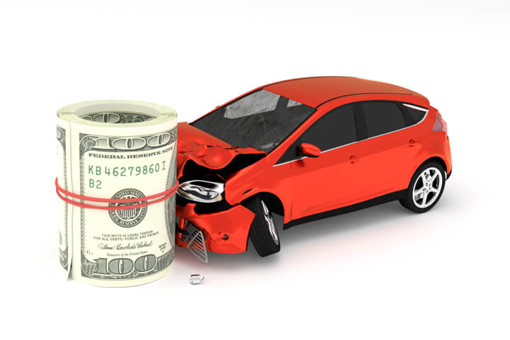 Compact car crashed into roll of money representing concept of the high cost of an accident on insurance rates