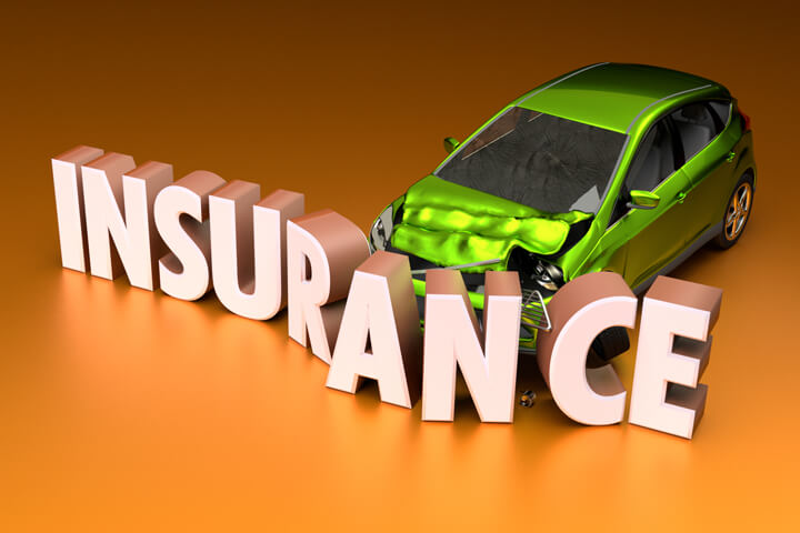 Small green compact car crashed into insurance word on orange background