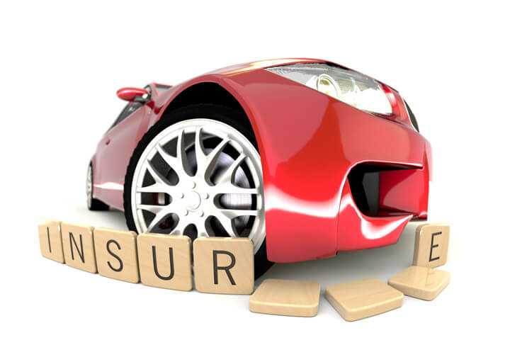 Fish eye view of red sports car knocking over wood insurance letters on white background