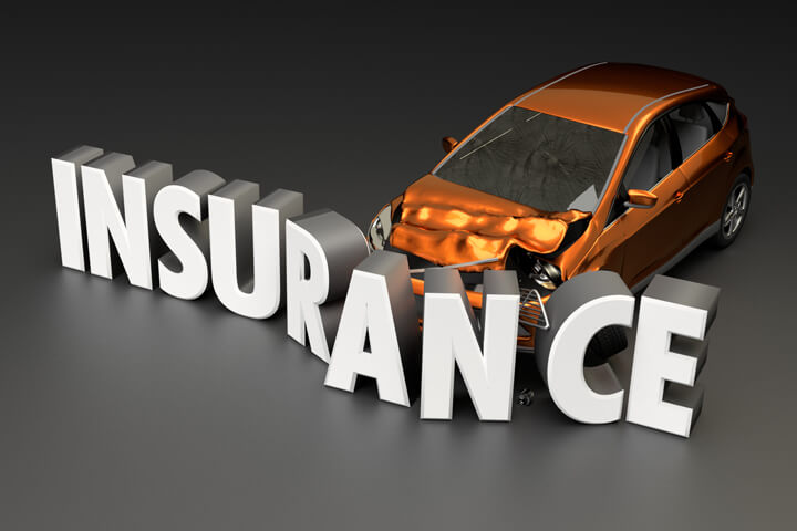 Car insurance concept of car crashed into insurance word on dark background